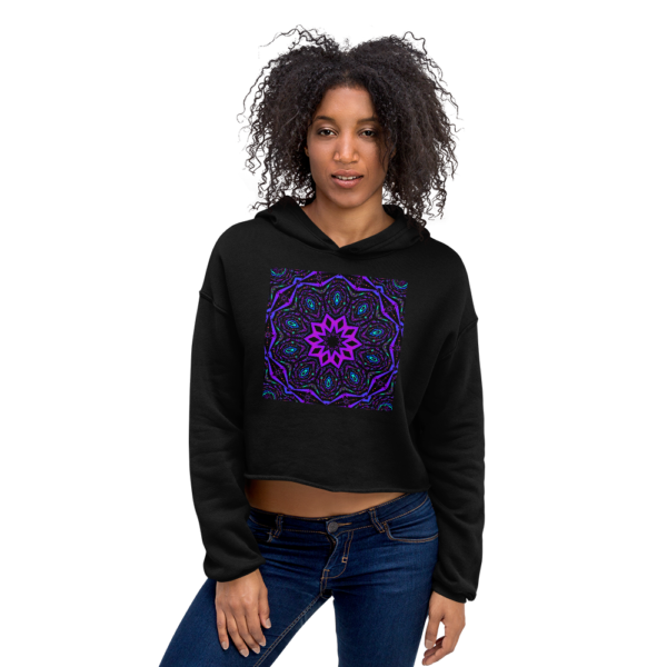 woman wearing purple artistic kaleidoscope design on a black crop top sweatshirt