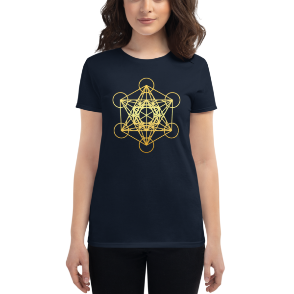 woman wearing dark navy t-shirt with a gradient gold metatron's cube sacred geometry in the front center