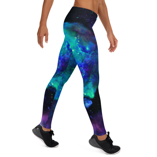 woman wearing yoga leggings with cool colored nebulae and metatron's cube