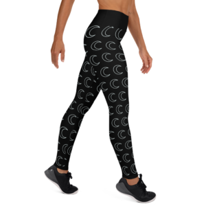 woman wearing black yoga leggings with white crescent moon pattern