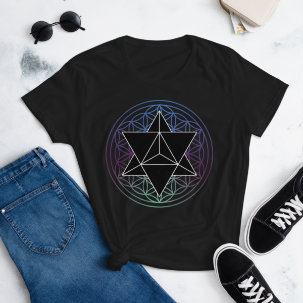 lifestyle photo of t-shirt with a black merkaba and a colored flower of life