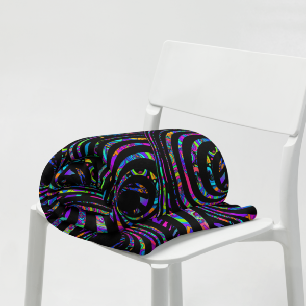 rolled up blanket on chair